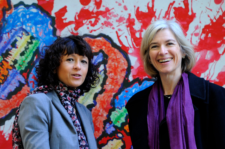French researcher in Microbiology, Genetics and Biochemistry Emmanuelle Charpentier (L) and US professor of Chemistry and of Molecular and Cell Biology, Jennifer Doudna posing beside a painting made by children of the genoma at the San Francisco park in Oviedo. - Emmanuelle Charpentier of France and Jennifer Doudna of the US on Tuesday, October 7, 2020 won the Nobel Chemistry Prize for research into the gene-editing technique known as the CRISPR-Cas9 DNA snipping tool. (Photo by Miguel RIOPA / AFP)